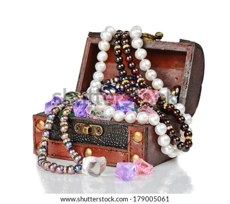 Wooden chest with jewels on a white background - stock photo