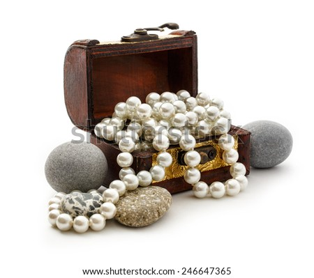 Wooden chest with white pearl necklace and sea stones - stock photo