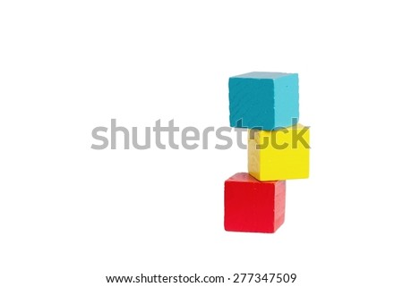 wooden childrens playing dice in different colors - stock photo