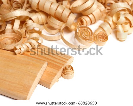 Wooden chips and planks over white background - stock photo