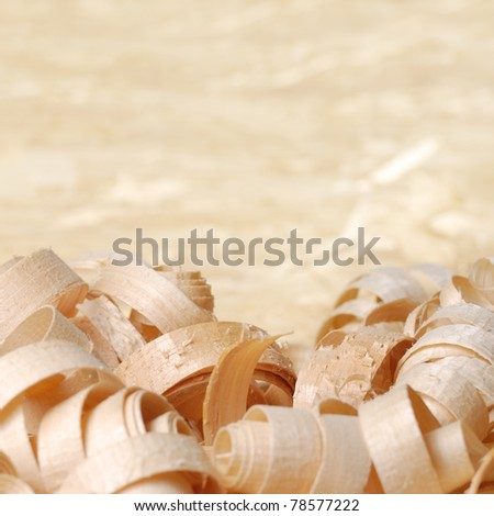 Wooden chips closeup on the plywood background - stock photo