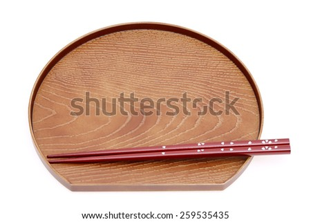 wooden chopsticks and plate isolated on white background - stock photo