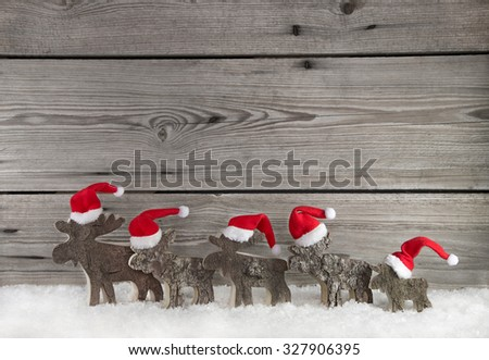Wooden christmas background with a group of santa clause on wood for decoration. - stock photo
