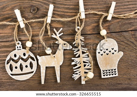 Wooden christmas decoration - christmas ball, deer, tree and mitten - stock photo