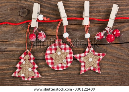 Wooden christmas decoration on wooden background - christmas ball,  tree and star - stock photo