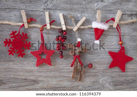 Wooden christmas deer and red stars on wooden background - stock photo