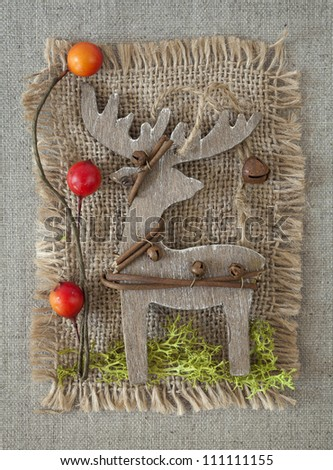 Wooden christmas deer on fabric background - stock photo
