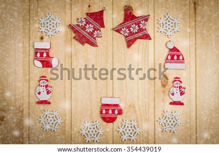 Wooden Christmas figurines snowmen snowflakes Christmas tree hat and stockings on a natural wooden background. - stock photo