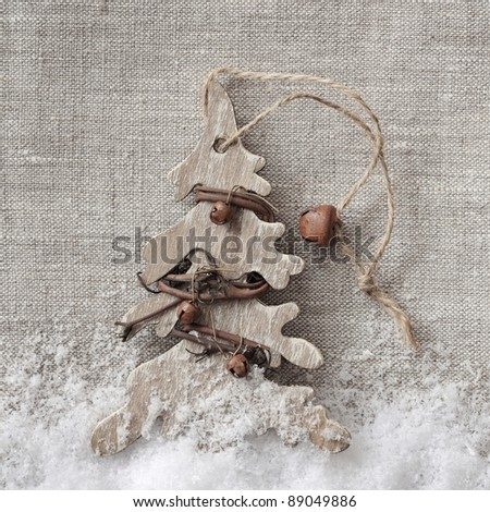 Wooden christmas tree on fabric background - stock photo