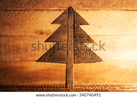 Wooden christmas tree on natural background - stock photo