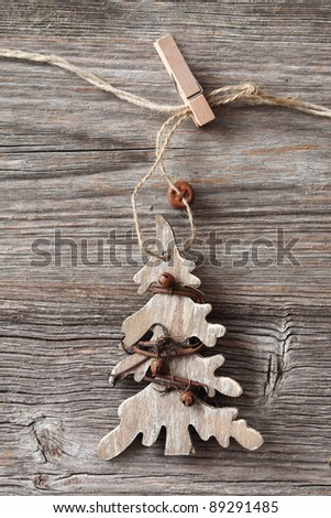 Wooden christmas tree on wooden background - stock photo