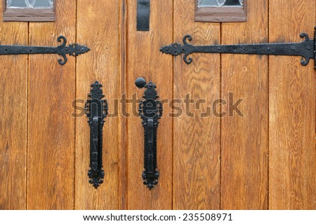 wooden church doors with ornate metal hardware - stock photo