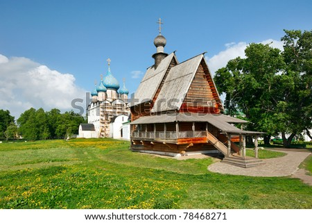Wooden church Nikola's and Nativity Cathedral in Suzdal Kremlin.The Suzdal Kremlin is the oldest part of Suzdal, dating from the 10th century. It was named a UNESCO World Heritage Site in 1992. - stock photo