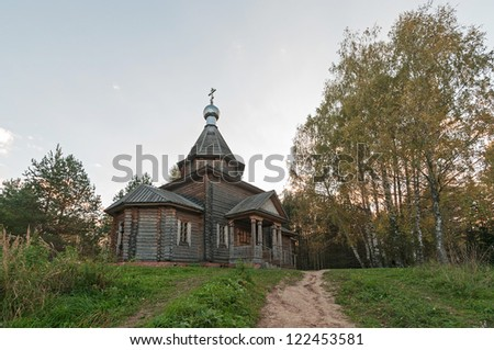 Wooden Church of the Kazan icon of the Mother of God on a hill against sky background. Vladimirskoe village, Nizhegorodsky region, Russia.