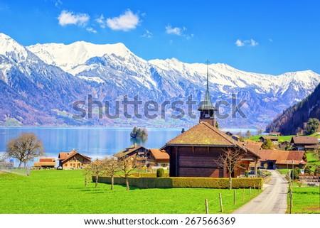 Wooden church with alpine lake landscape in background, Bern, Switzerland - stock photo