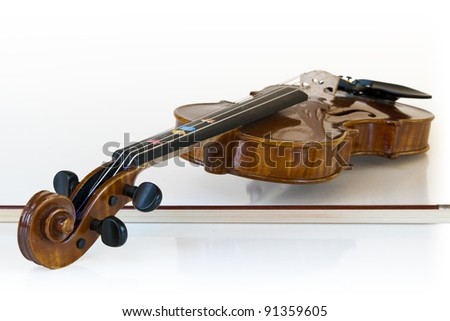 wooden classic violin lying on it's stick with white background - stock photo