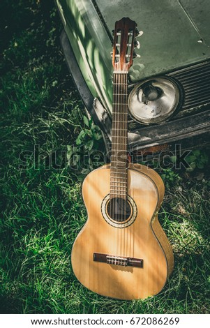 Wooden Classical Guitar Outside On A Grass Next To Vintage Car