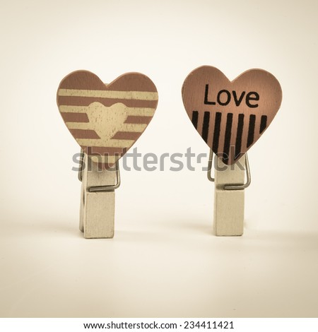 wooden clips with love symbol - stock photo