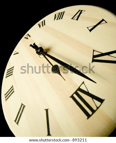 Wooden clock on black