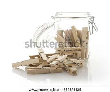 wooden clothes pegs in a glass Jar - stock photo