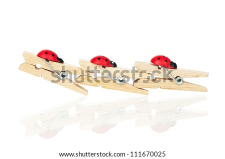 Wooden clothespin in a row on white background