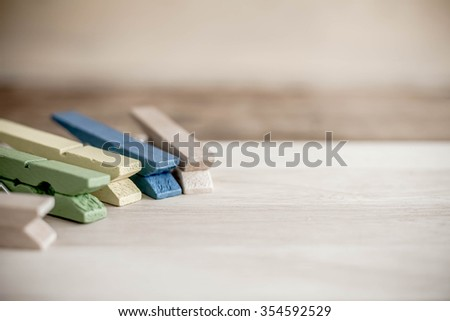 Wooden Clothespin on wood background. - stock photo