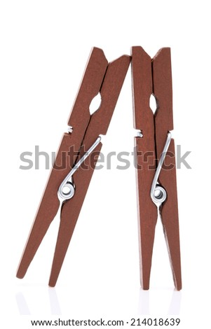 wooden clothespins isolated on a white background - stock photo