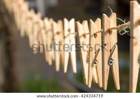 Wooden clothespins on the clothesline. - stock photo