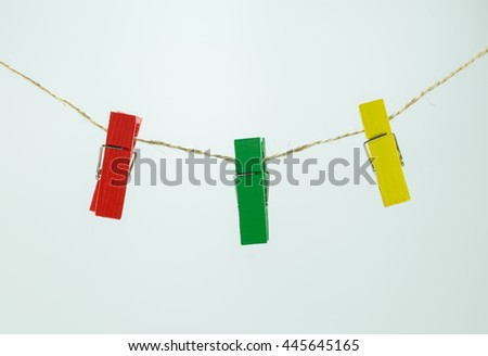 Wooden clothespins on white background. - stock photo