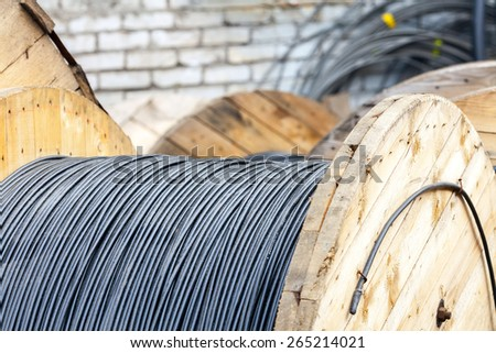 Wooden Coils Of Electric Cable Outdoor. Industrial Object Photo - stock photo