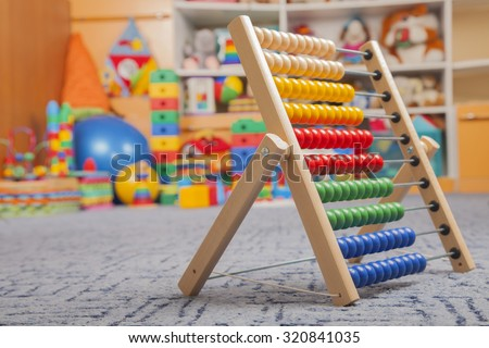 wooden color abacus in room for children - stock photo