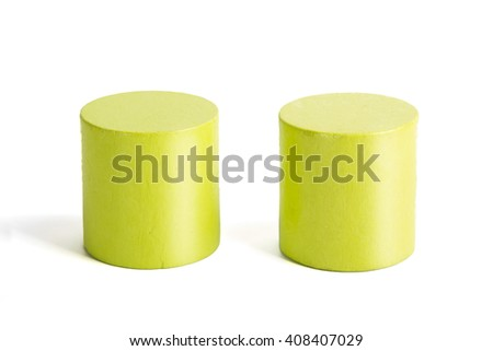 Wooden color green cylinders on a white background - stock photo