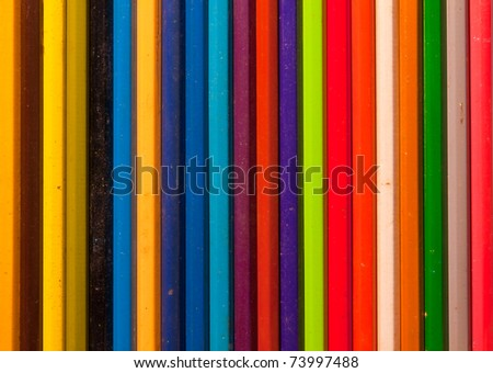 Wooden color pencils in striped pattern with varry colors