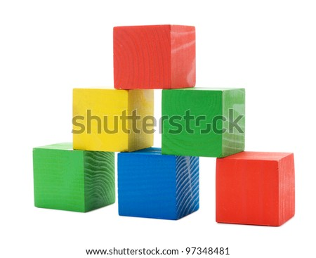 Wooden colored building pyramid of cubes toys isolated on white background - stock photo