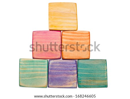Wooden colored toys blocks isolated on white - stock photo