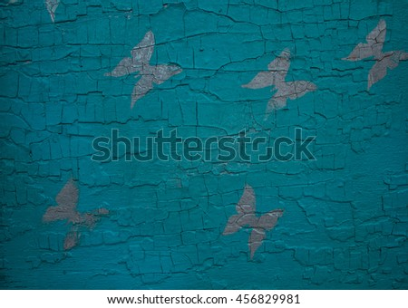 Wooden colorful background with butterflies.