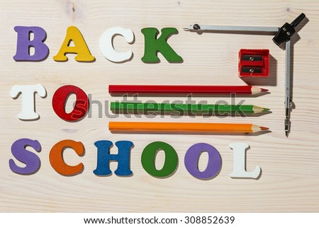Wooden Colorful Letters Spelling Back To School And School Office Supplies. Copy Space