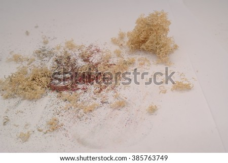 Wooden colorful pencils with sharpening shavings on isolated white background - stock photo