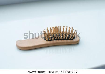 wooden comb - stock photo