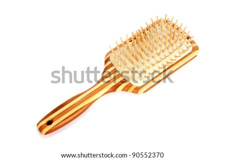 Wooden comb isolated on white background. - stock photo