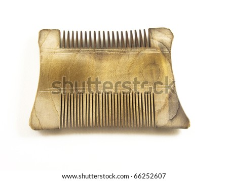 Wooden comb with white background. - stock photo