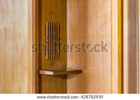 wooden confessional in a Christian church - stock photo