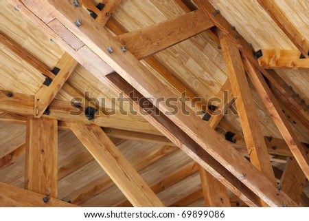 Wooden construction - roof truss made of beams - stock photo