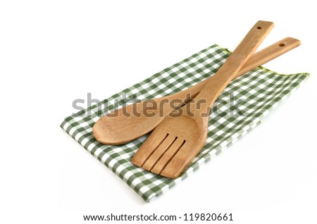 Wooden cooking utensils isolated on white background - stock photo