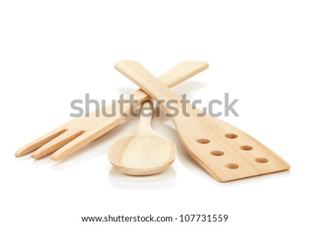 Wooden cooking utensils. Isolated over white background - stock photo