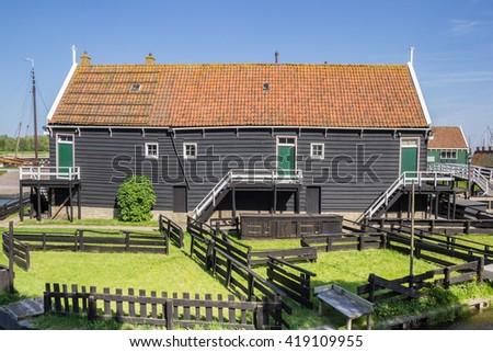 Wooden cottage at the lake in Enkhuizen, Holland - stock photo