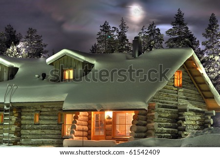 Wooden cottage in the winter's evening. Finland. - stock photo