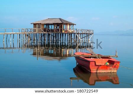 Wooden cottage lake settlement, Greece - stock photo