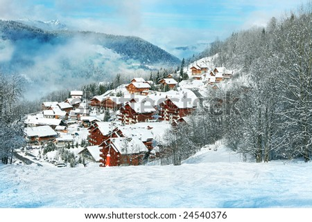 Wooden cottages in the forest covered by snow - stock photo