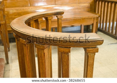 Wooden court bench. Vintage style court room close up. - stock photo